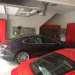 Custom Garage Cabinets Red with Slatwall Storage and Parked Cars